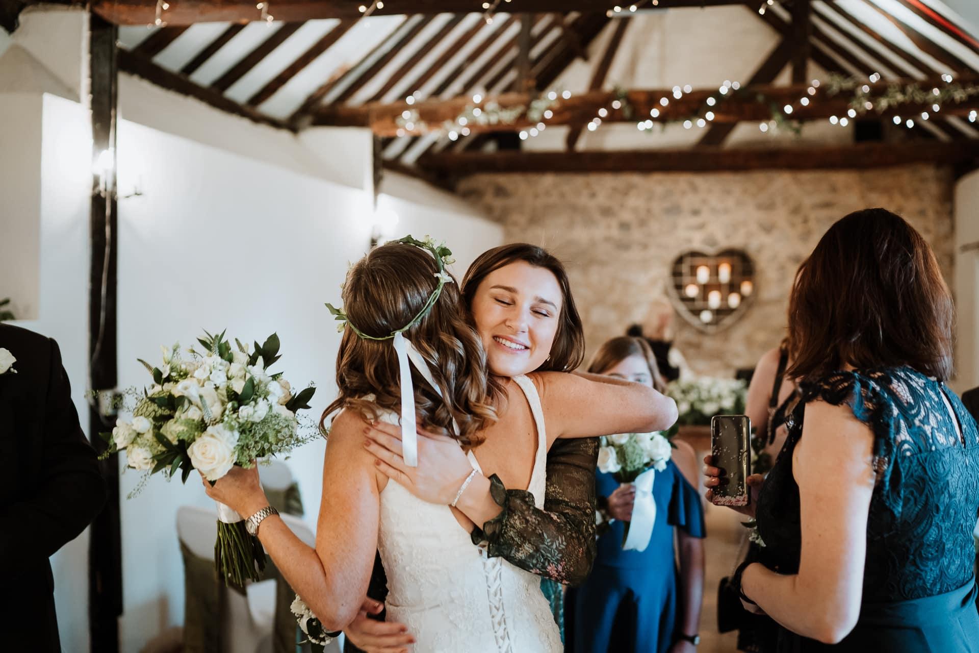 Bride hugging a relative after her ceremony