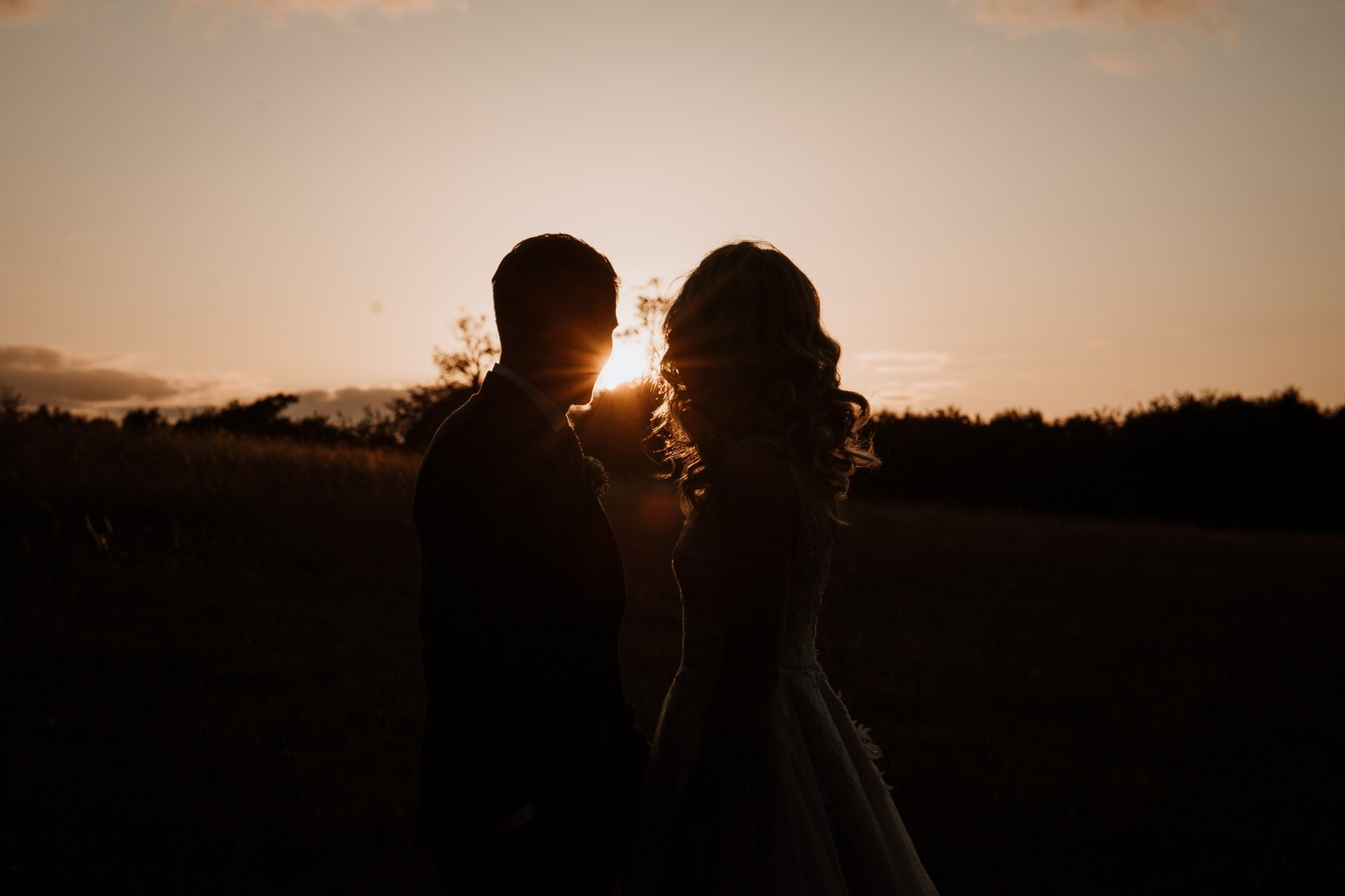 Bride and Groom looking as the sunsets on their wedding day