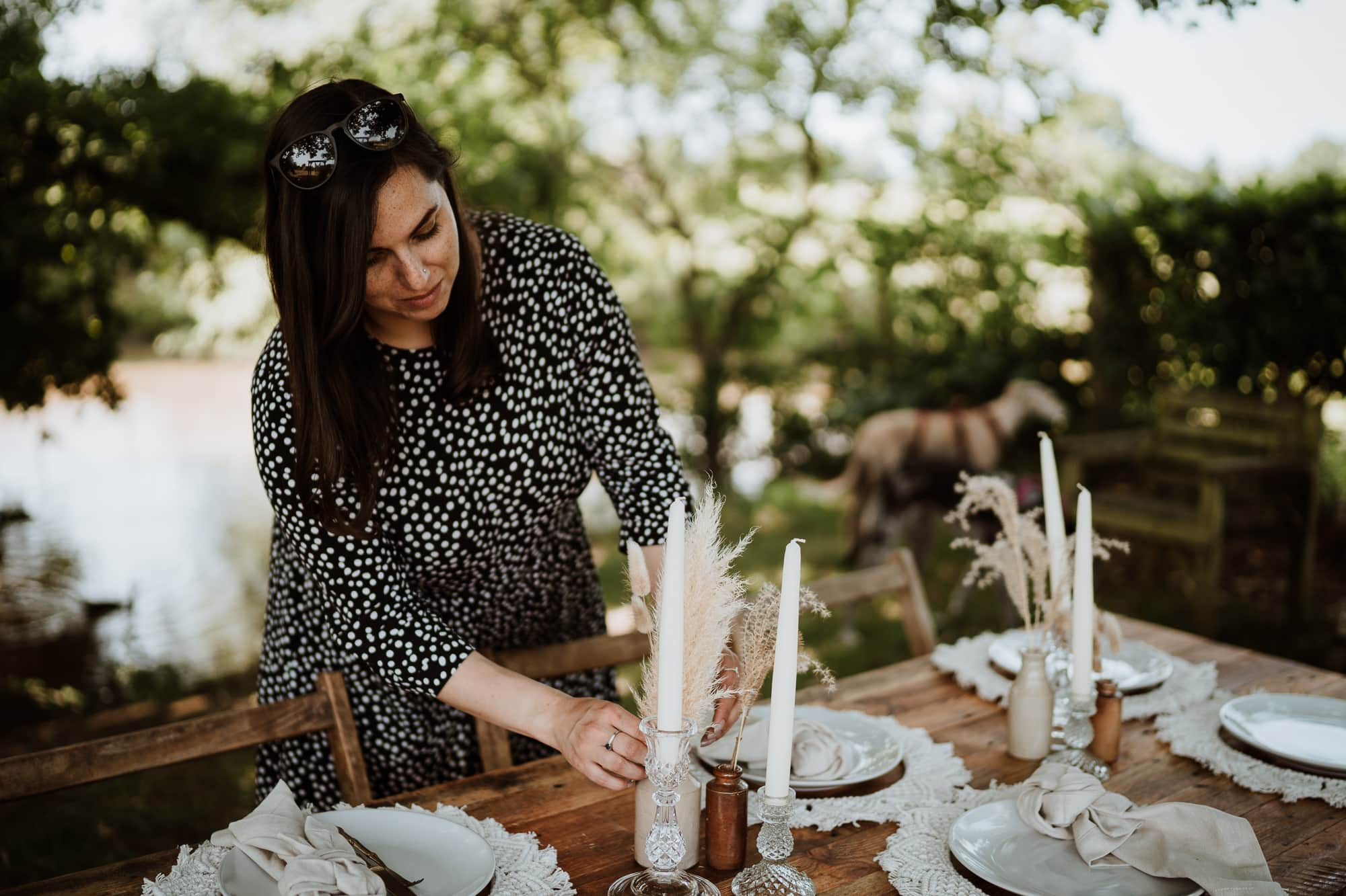 Kent wedding supplier the little wedding warehouse setting a rustic wedding table in woodland setting