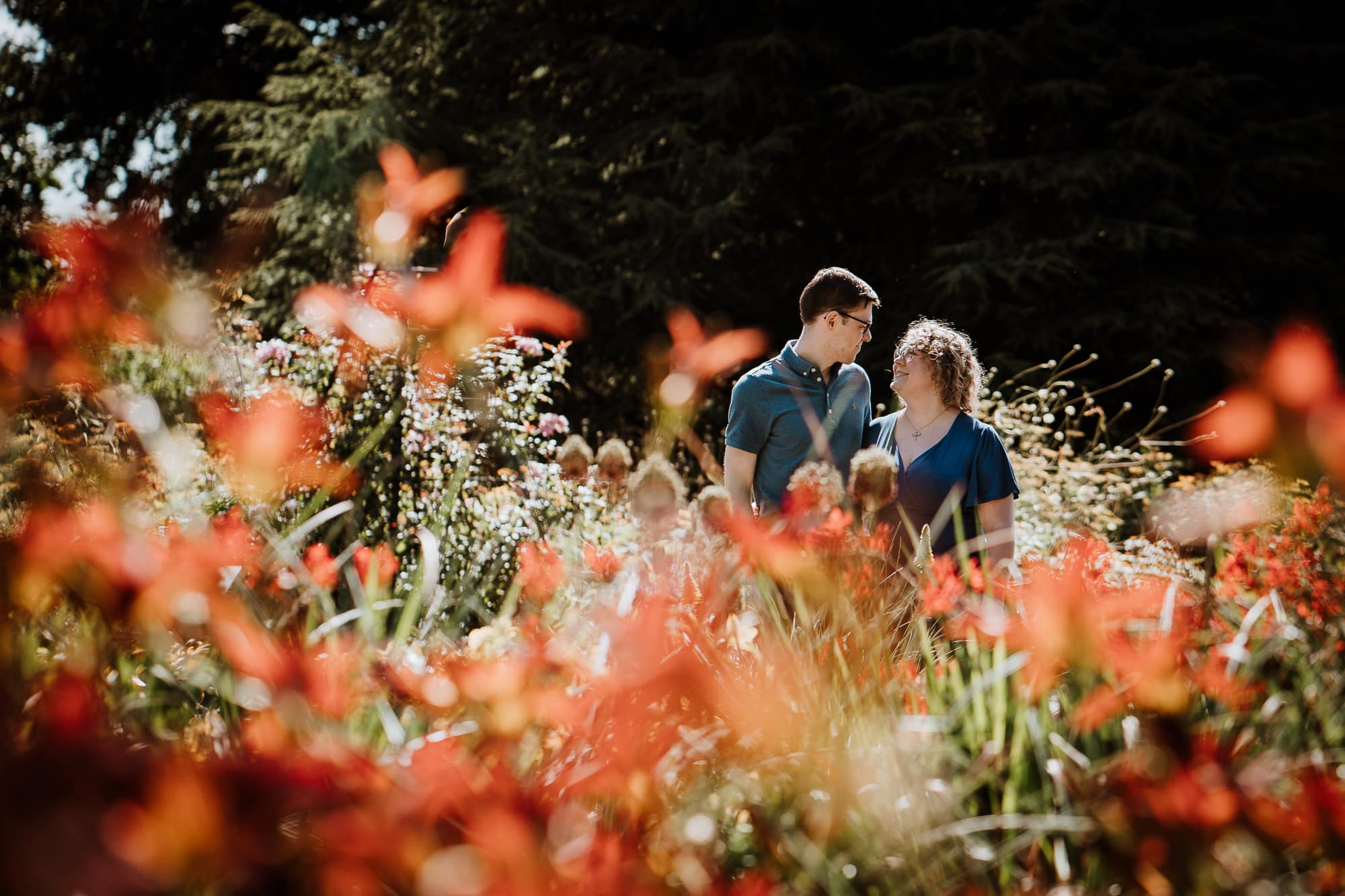 Couple looking at each other happily in flowers