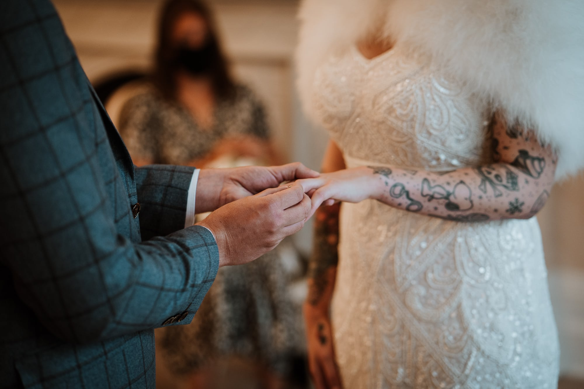 Groom placing ring on his Brides finger
