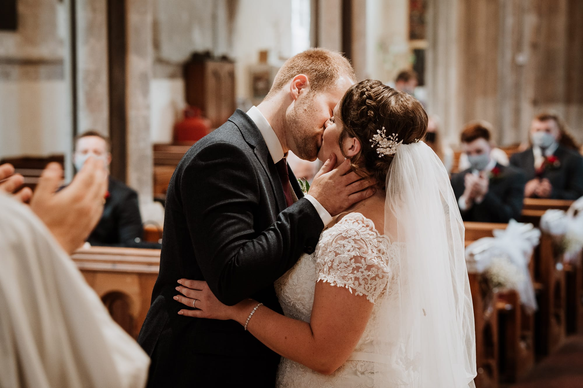 Bride and Groom having their first kiss as Husband and Wife