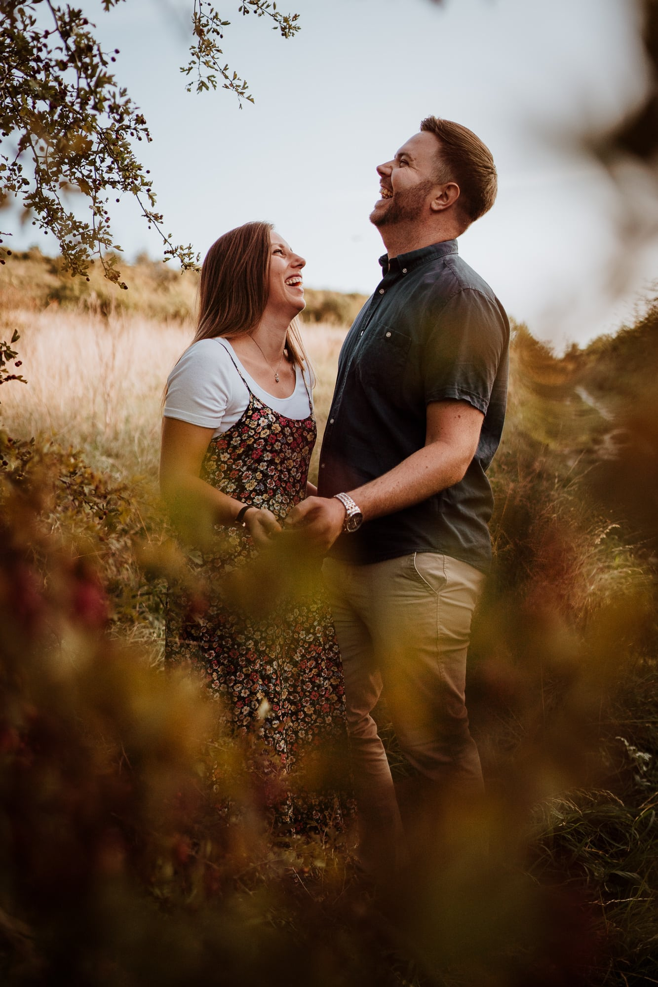 Couple laughing together during engagement shoot