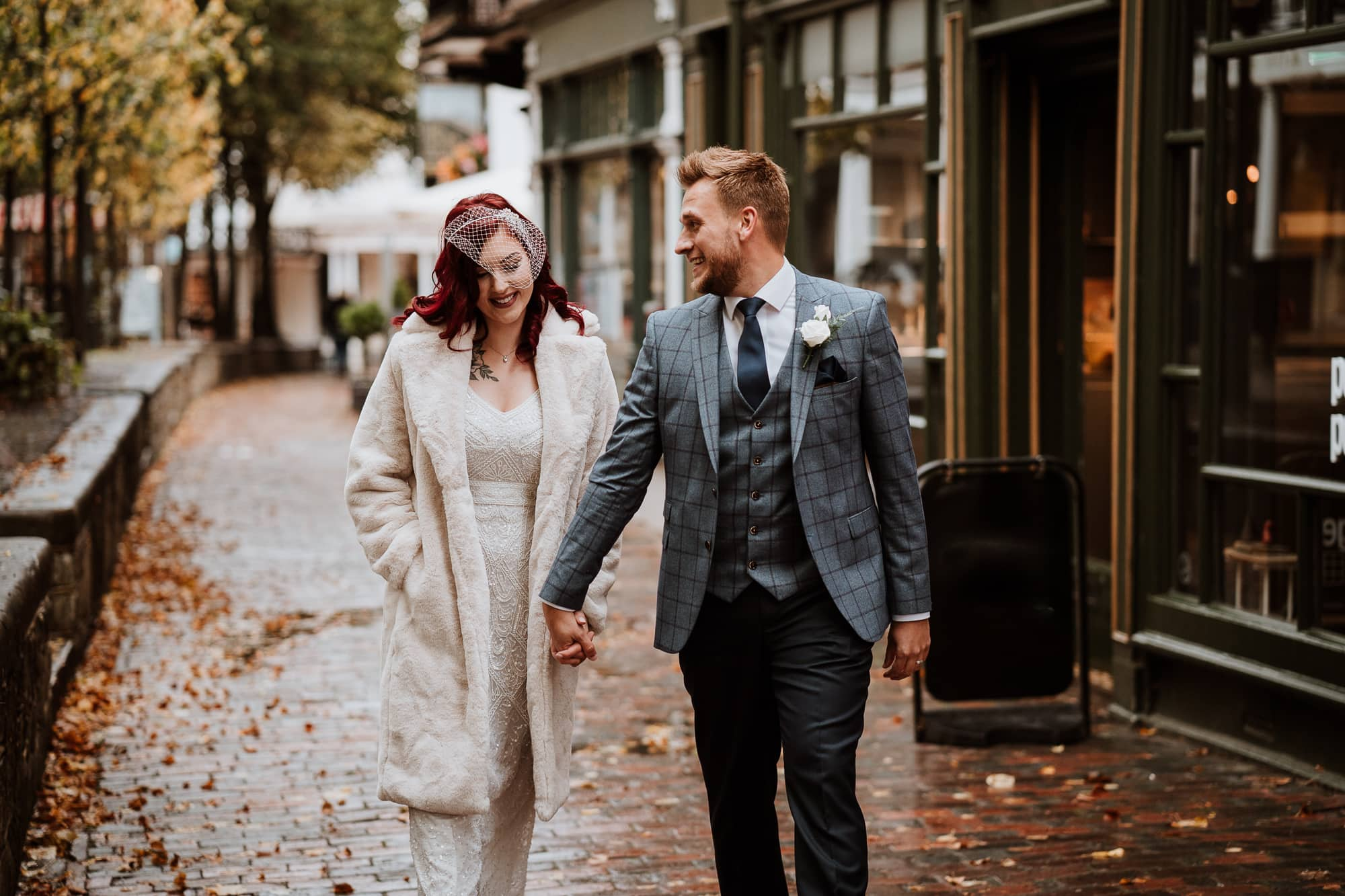 Bride and Groom walking during their Wedding portraits in The Pantiles