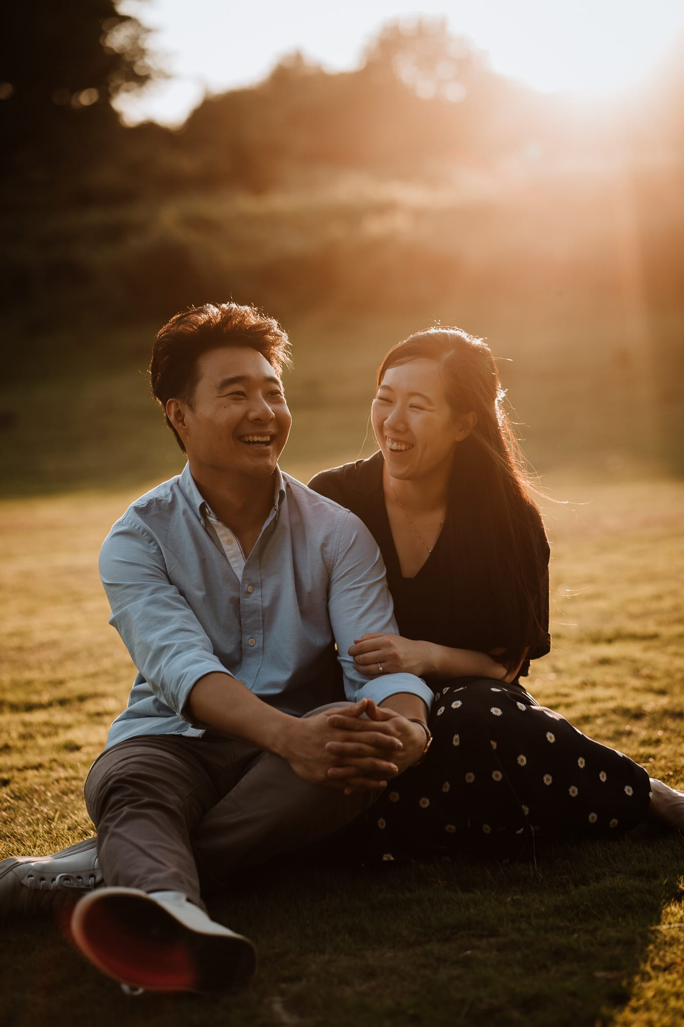Couple seated and laughing in the sunset