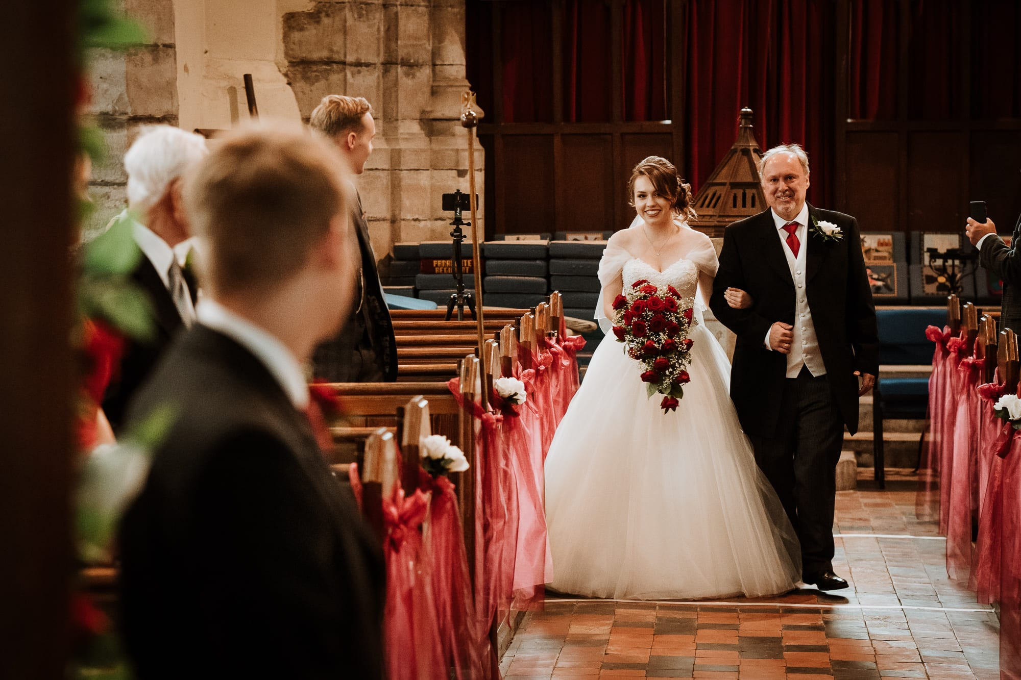 Bride and Groom looking at each other for the first time as she is walked down the aisle by her father