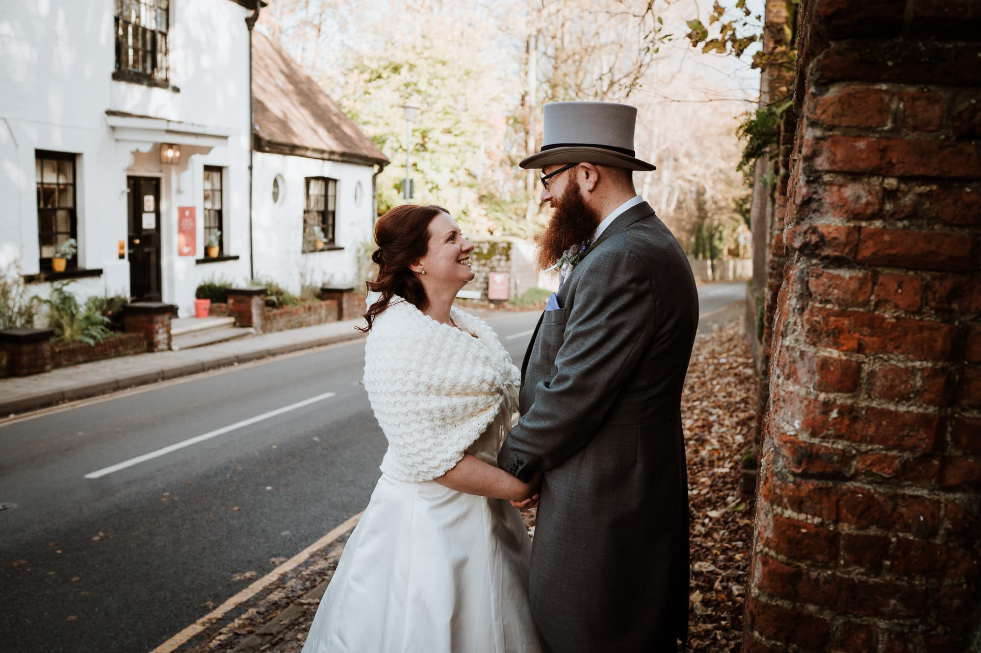 Bride and Groom holding hands opposite the Bull Hotel in Kent