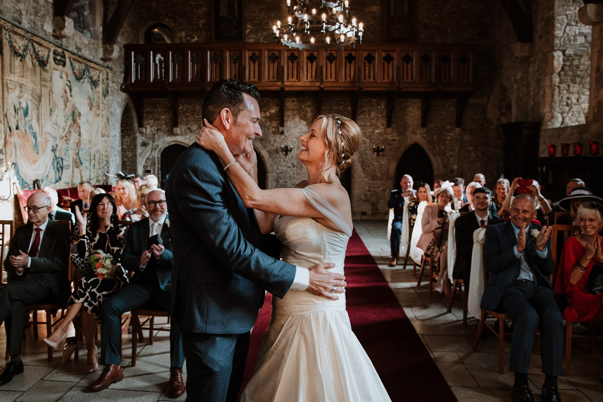 Bride and Groom looking at each other smiling happily after their ceremony in the Great Hall