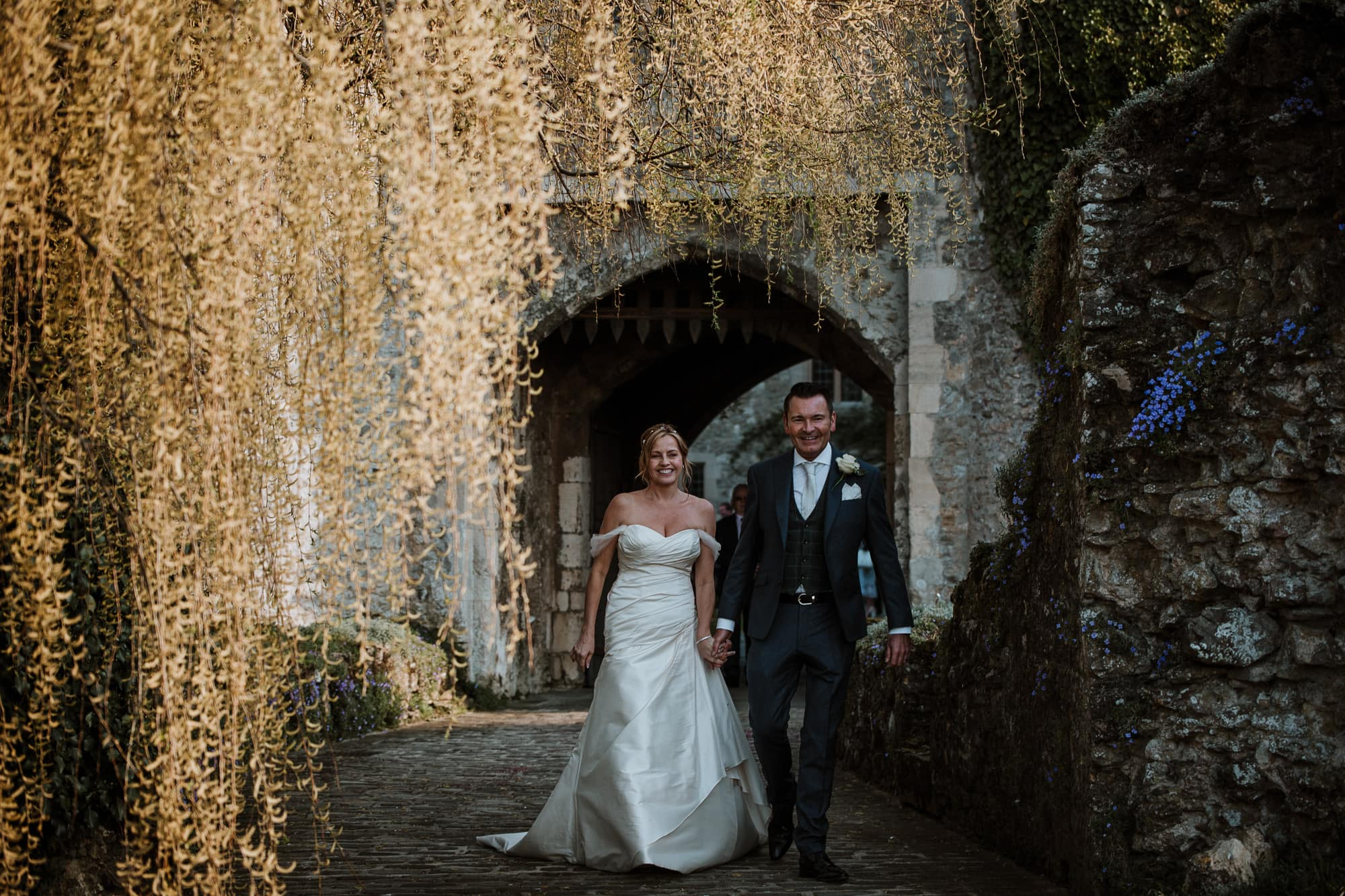 Bride and Groom leaving the castle gates at Allington