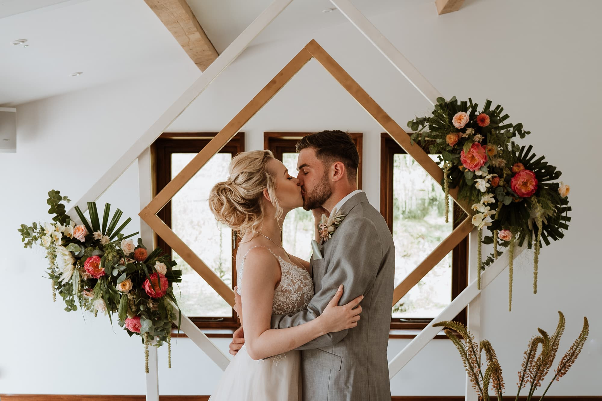Bride and Groom kissing during ceremony at The Oak Barn, Frame Farm