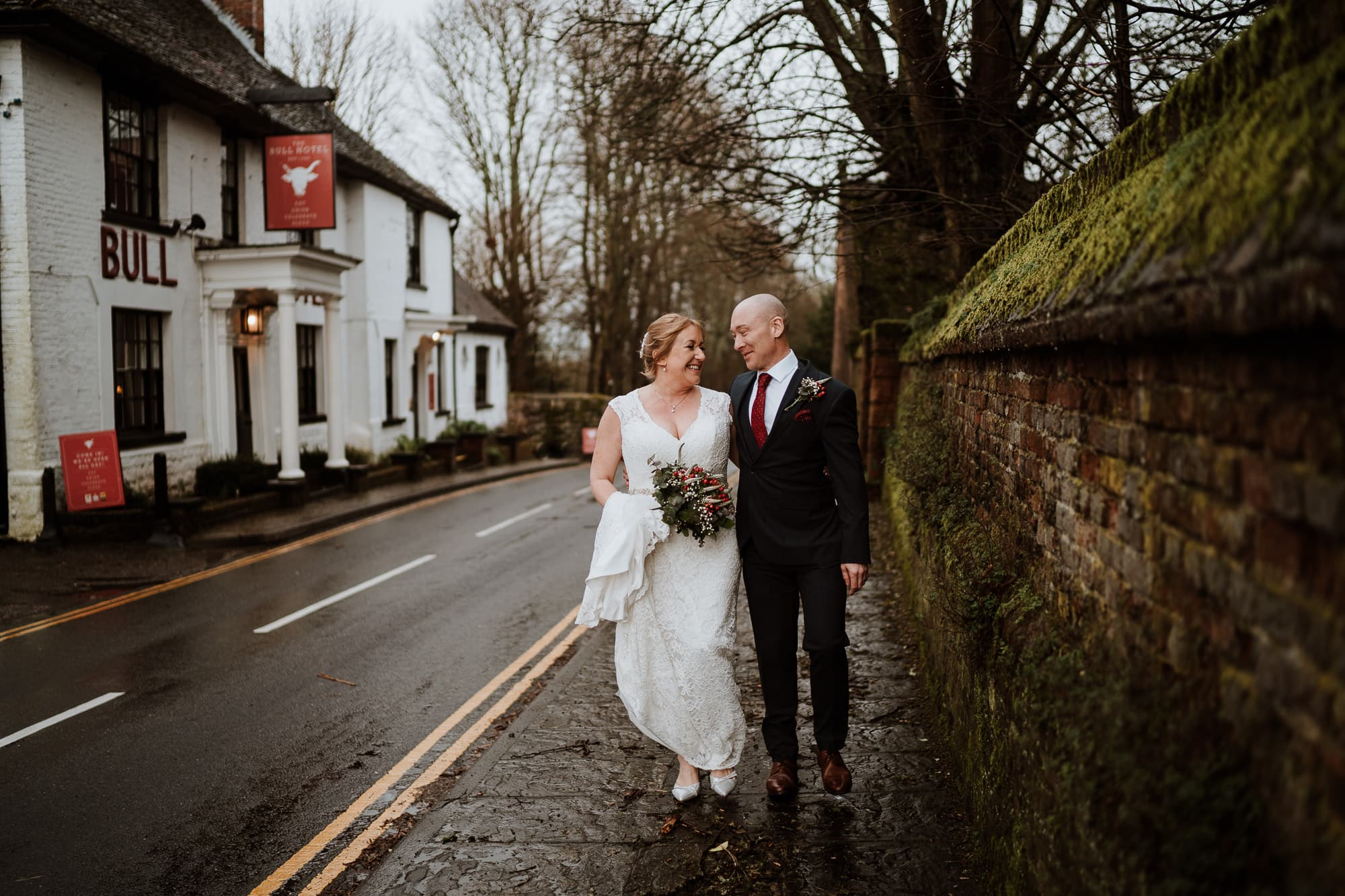 Couple smiling and walking together at their Wedding at The Bull Hotel, Wrotham