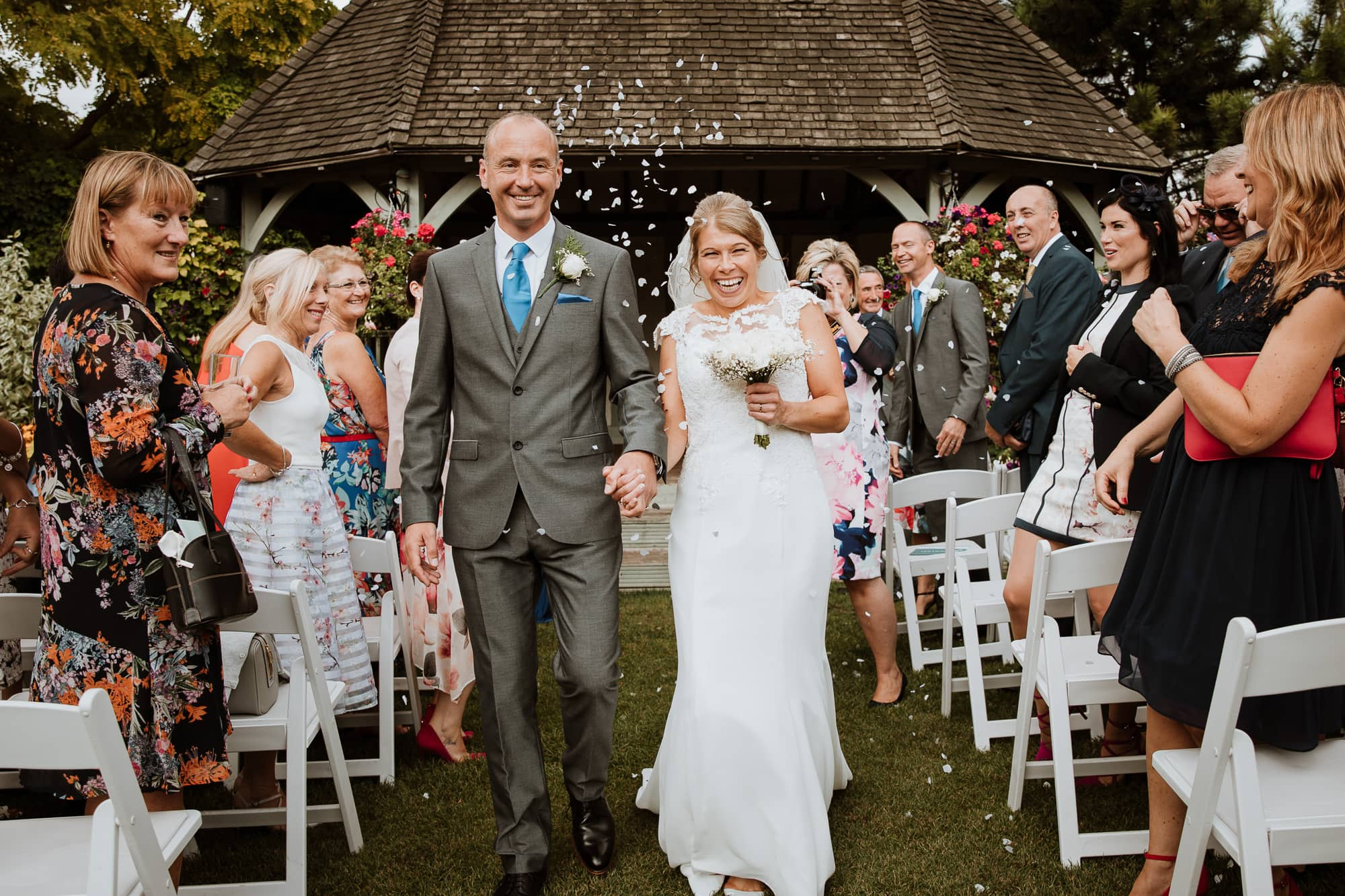 Bride and Groom being showered with confetti after their Kent Wedding ceremony