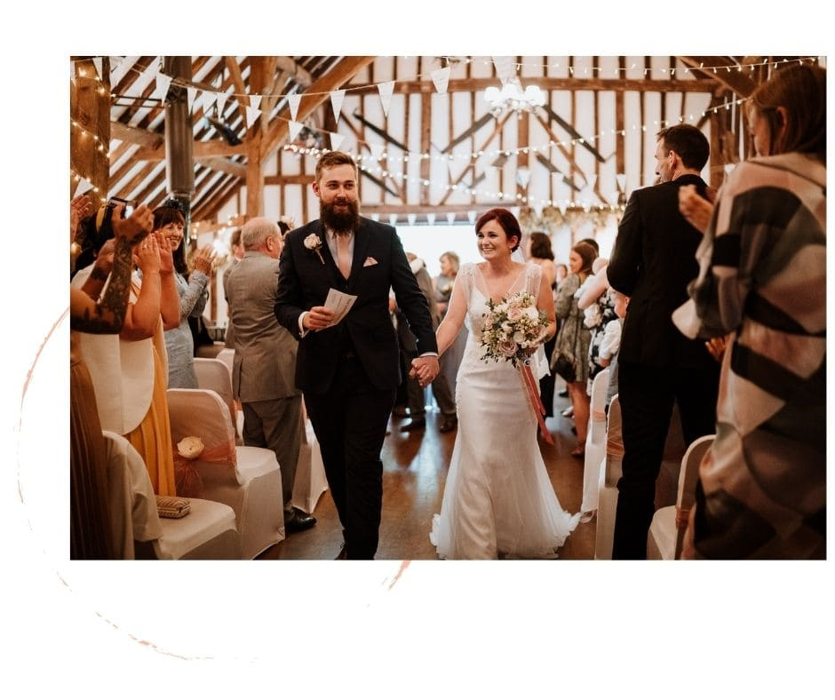 Documentary image of happy couple walking down the aisle